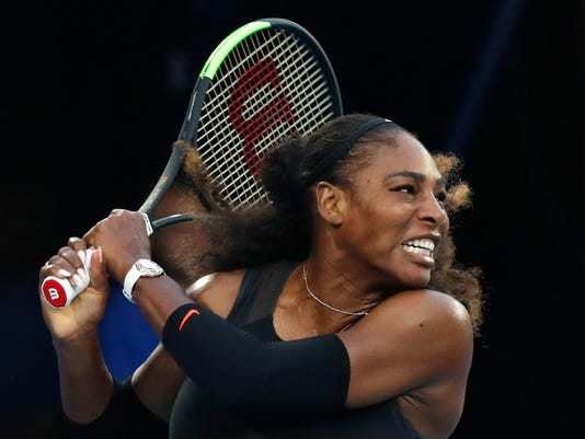 FILE - In this Jan. 28. 2017, file photo, United States' Serena Williams follows through on a backhand return to her sister Venus during the women's singles final at the Australian Open tennis tournament in Melbourne, Australia. The U.S. Tennis Association says Williams will return to competition for the first time in more than a year at the country's Fed Cup matches against the Netherlands next month. Williams has not played an official match since winning the Australian Open in January 2017 for her 23rd Grand Slam singles title. She was pregnant during that tournament and gave birth to a daughter on Sept. 1. (AP Photo/Kin Cheung. File)