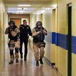 Law enforcement takes part in an emergency drill inside a primary school in Hudson Falls, N.Y. last year.