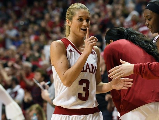 Indiana Hoosiers guard Tyra Buss (3) holds up one finger