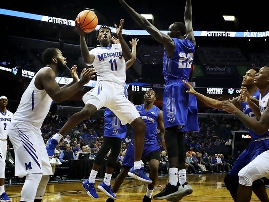 University of Memphis guard Malik Rhodes (11) shoots