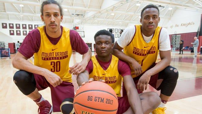 Mount Vernon High School boys basketball players, from left, Noah Morgan, Greg Calixte, Eric Monroe photographed during practice at Mount Vernon High School on Thursday, March 16, 2017.