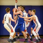 Falcon Evan Horn (33) is surrounded by Cedars after pulling down a rebound. Cedar Crest defeated Lebanon 44-32 in the match up in Cedar territory.