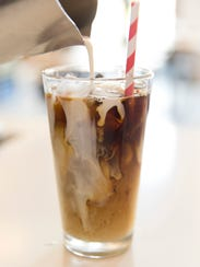 Ice coffee is poured at Beau Basin in Carencro July