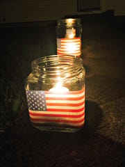 Patriotic-themed votive candles are easy to assembly using free clip art.