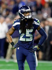 Seahawks cornerback Richard Sherman reacts to a 28-24 loss to New England in Super Bowl XLIX.