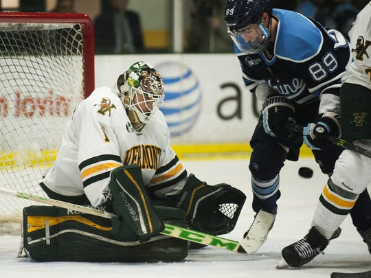 Catamounts goalie Mike Santaguida (1) makes a save during the Hockey East quarterfinal men's hockey game between the Maine Blackbears and the Vermont Catamounts at Gutterson Fieldhouse on Saturday night.