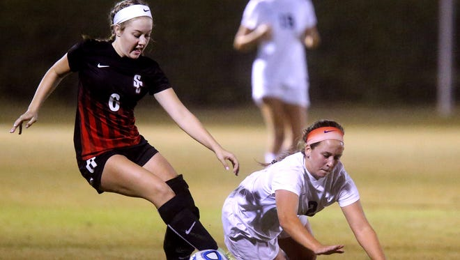 Siegel's Ashley Lawson (2) falls to the ground as Stewart Creek's Taylor Crutcher (6) tries to maneuver the ball during the 7-AAA Championship game at Siegel Soccer Complex, on Thursday, Oct. 13, 2016.