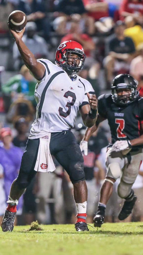 Clinton quarterback Cam Akers (3) releases a pass in the first half. The Class 6A MHSAA football game was played Friday, September 5, 2014 in Brandon.