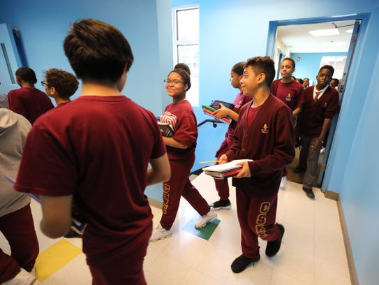 Students change class at the K-8 Charter School of