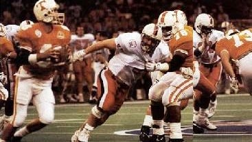 Andy Kelly looks for a target in the 1991 Sugar Bowl.