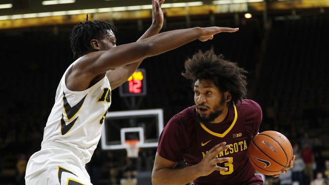 Minnesota forward Jordan Murphy, right, drives past Iowa forward Tyler Cook, left, during the first half of an NCAA college basketball game, Tuesday, Jan. 30, 2018, in Iowa City, Iowa. (AP Photo/Charlie Neibergall)