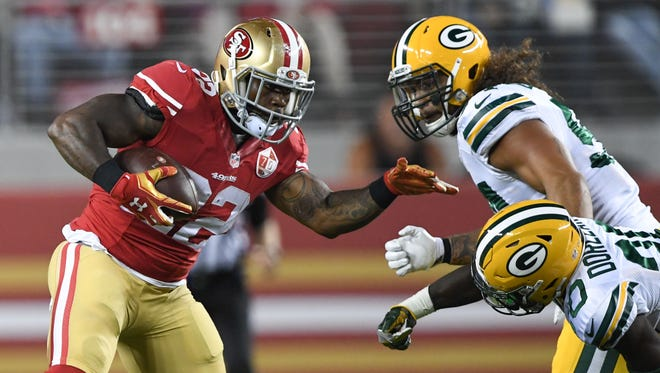 San Francisco 49ers running back Mike Davis (22, left) runs the football against Green Bay Packers defensive back Makinton Dorleant (20), a Lely High School graduate, during the third quarter at Levi's Stadium on Aug. 26, 2016.