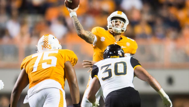 Tennessee quarterback Jarrett Guarantano (2) passes under pressure from Southern Miss linebacker Paxton Schrimsher (30) during Saturday's game.