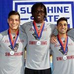 Men's swimming 200m relay repeats; women's lacrosse cruises