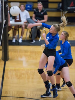 Gracyn Smith (11) leaps to return a ball during the Pace vs Pensacola high school District 1-7A Championship volleyball match at Milton High School on Thursday, October 19, 2017.