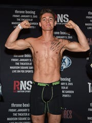 Dustin Fleischer, from Monmouth Beach, flexes his muscles before his professional boxing debut Friday, a televised event at The Theater at Madison Square Garden in New York City.