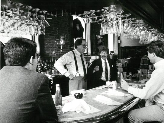 Former Channel 3 reporter Earle Farrell (wearing suspenders)