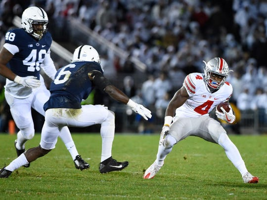 Ohio State' Curtis Samuel looks to duck Penn State