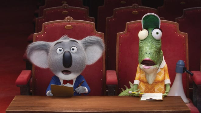 "Buster Moon (left, voiced by Matthew McConaughey) and his assistant Miss Crawley (voiced by writer/director Garth Jennings) are stunned by a potential contestant in ""Sing."""