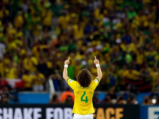 Brazil's David Luiz celebrates after Brazil's 2-1 victory to advance to the semifinals during the World Cup quarterfinal soccer match between Brazil and Colombia at the Arena Castelao in Fortaleza, Brazil, Friday, July 4, 2014. Luiz scored his side's second and decisive goal. (AP Photo/Andre Penner)