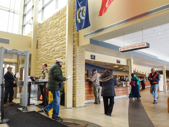 Drivers enter the Stearns County Service Center to