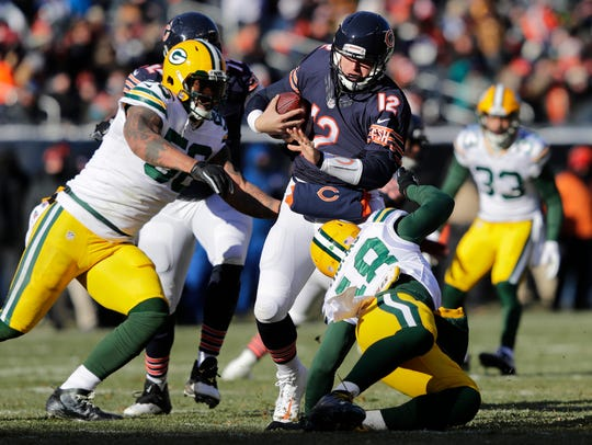 Chicago Bears' Matt Barkley is under pressure from