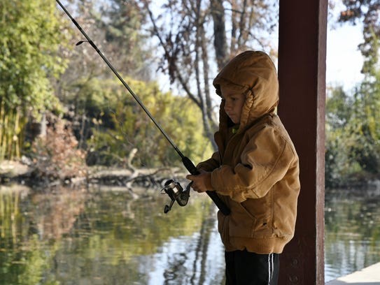 Jaxen Hill, 4, waits for a fish to bite at Mooney Grove
