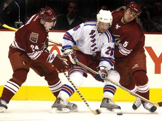 Martin Rucinsky (26) of the New York Rangers is knocked