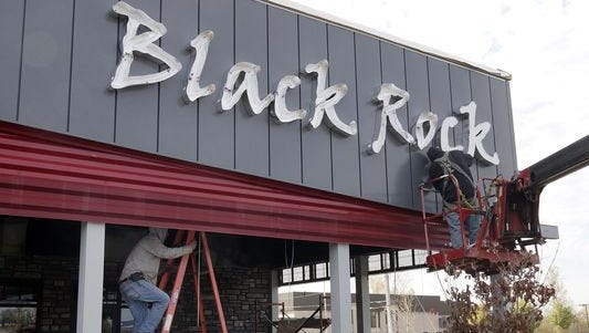 The Black Rock sign goes up Monday, six days before opening day.