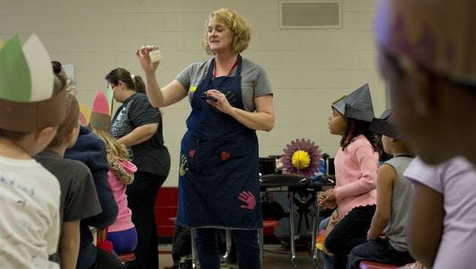 Kindergarten teacher Andrea Cansfield tells students how to make their own butter during a party before the beginning of Thanksgiving break Friday, Nov. 20, 2015, at Cleveland Elementary School.