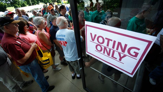 Republicans enter Hilton Coliseum before casting their ballots in the Iowa Republican Party's Straw Poll on Aug. 13, 2011, in Ames, Iowa.