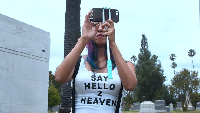 """Soundgarden fan Melody Andrade, wearing a """"Say Hello 2 Heaven"""" t-shirt, attends the funeral service for Soundgarden frontman Chris Cornell on May 26, 2017 at the Hollywood Forever Cemetery in Los Angeles, California."""