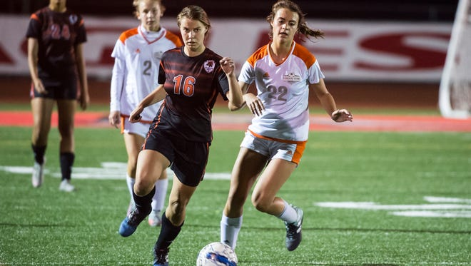 Central York's Chloe Carns (22) and Northeastern's Amanda Bentz (16) fight for the ball during play in the YAIAA Championship game on Thursday, Oct. 29, 2017. Central York won 1-0.