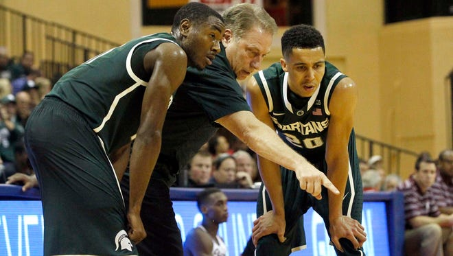Michigan State Spartans head coach Tom Izzo talks with guard Lourawls Nairn Jr. (11) and guard Travis Trice (20) against the Rider Broncs during the first half at HP Field House.
