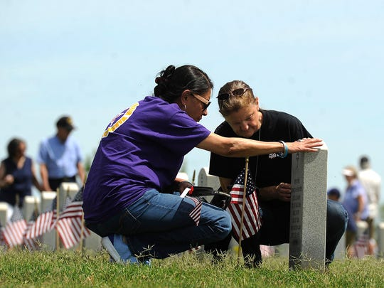 Gold Star mothers Carmen Balint (left) and Donna Kleman visit the gravesite of Kleman's daughter, Chief Warrant Officer 2 Jennifer C. Hunter after the Memorial Day ceremony on Monday, May 29, 2017, at the Texas State Veterans Cemetery at Abilene.