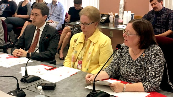 Public Library of Cincinnati and Hamilton County board President Allen Zaring, board member Elizabeth LaMacchia and executive director Kim Fender speak to the Hamilton County Board of Commissioners Monday.