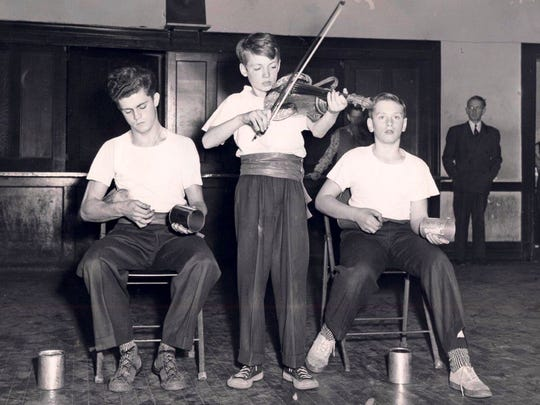 Carl Harris, left, Herman Powers and James Beal perform a musical show in 1947 at St. Joseph's Orphanage on Frankfort Avenue in Crescent Hill.