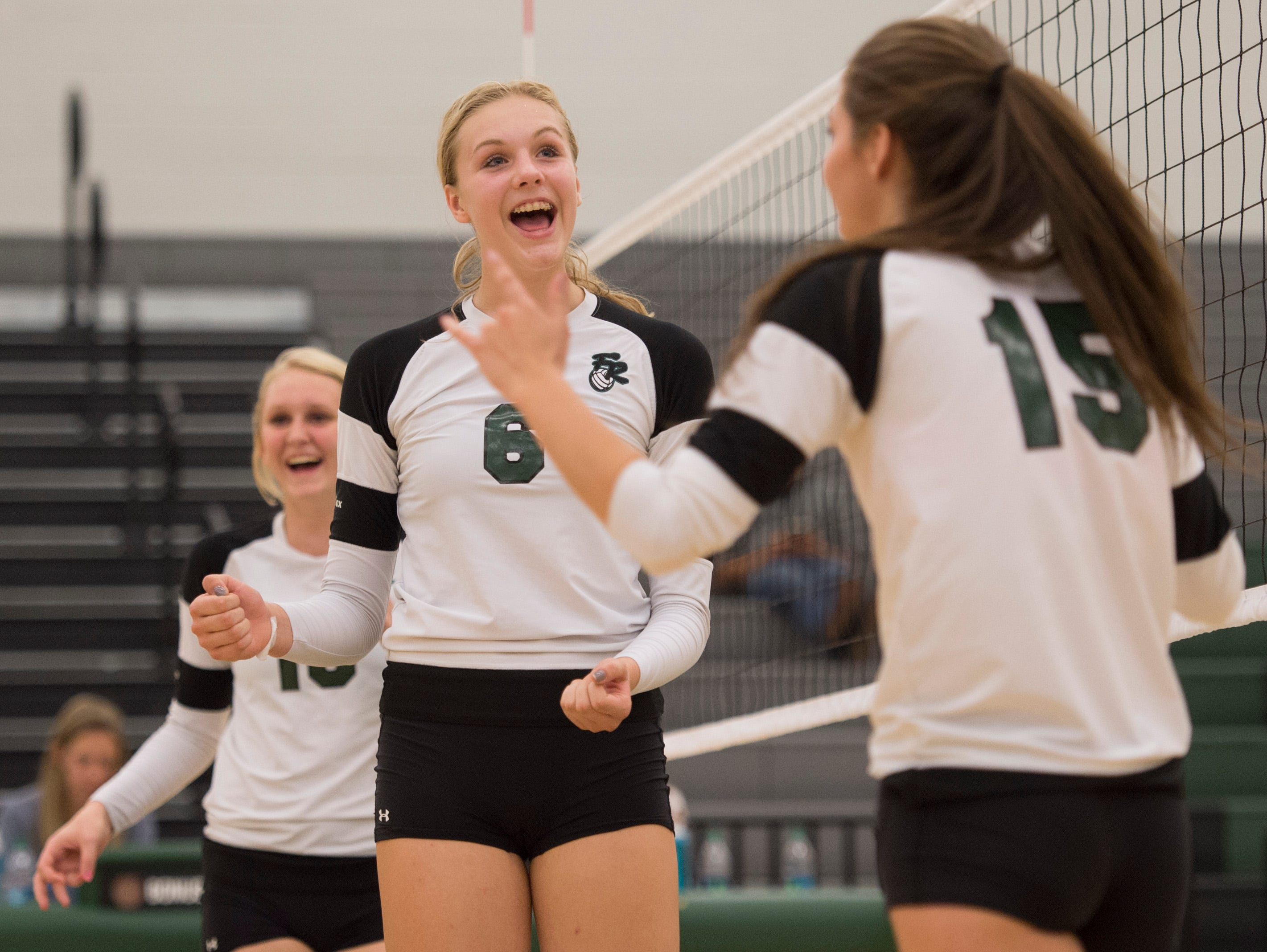 Riley Zuhn of Fossil Ridge celebrates with her teammates during a game against Horizon at Fossil Ridge High School Tuesday, September 29, 2015. The SaberCats swept Horizon High School 3-0.