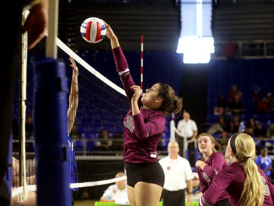 Eagleville's Tori Laidig (30) tips the ball over the