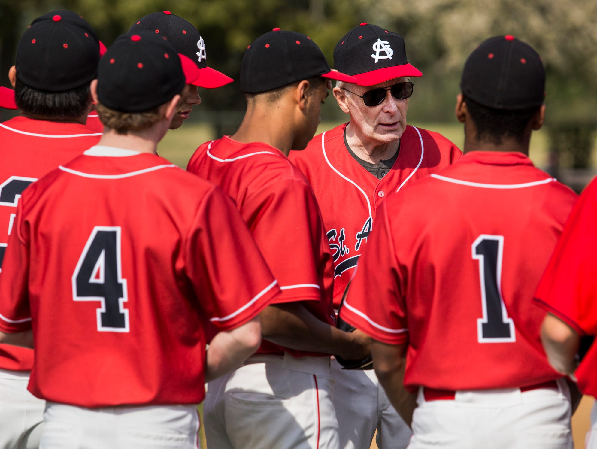 St. Andrew's head coach Bob Colburn talks with his players before the start of a game at St. Andrew's School in Middletown on Thursday afternoon.