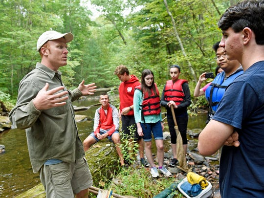 Tom Parke, left, talks to a group at Laurel Lake on Monday, Sept. 26, 2016. Students from Chambersburg Career Magnet School conducted a watershed exploration with members of Chesapeake Bay Foundation during the Susquehanna Watershed Education Program (SWEP).