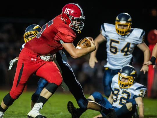 Annville-Cleona's Noah Myers fights for more yardage as Annville-Cleona defeated Elco 37-14 on Friday, night.