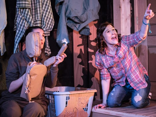 """Puppeteer Elizabeth Chinn Molloy, left, and Nicole Jeannine Smith are central characters in the world premiere production of Karen Hartman's """"SuperTrue,"""" running through Feb. 10 at the Know Theatre in Over-the-Rhine."""