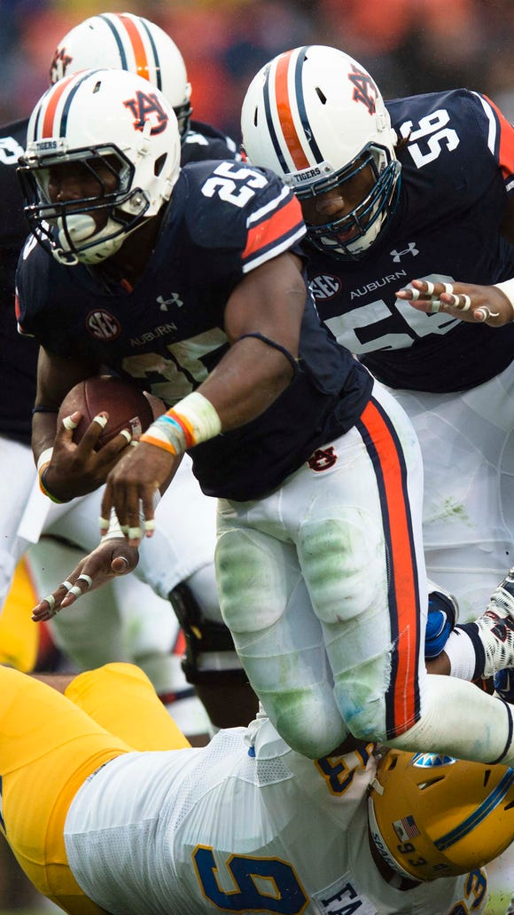 Auburn running back Peyton Barber (25) runs downfield during the NCAA football game between Auburn and San Jose State on Saturday, Oct. 3, 2015, at Jordan-Hare Stadium in Auburn, Ala. Auburn defeated San Jose State 35-21.