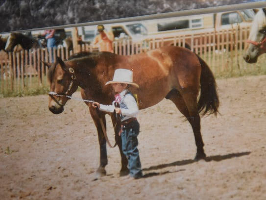 Lacey Kuschel is pictured at a horse show in a photograph