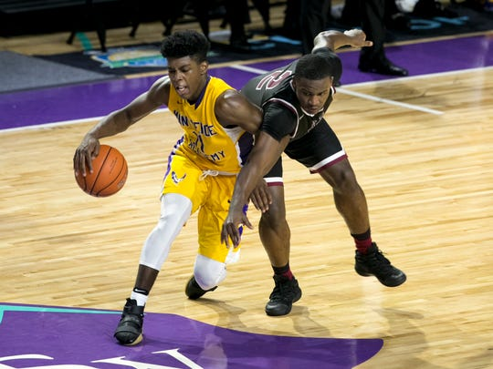 Memphis East's Alex Lomax tries to steal the ball from Marcus Carr of Montverde Academy in the finals of the 44th Annual City of Palms Classic on Wednesday, December 21, 2016, at Suncoast Credit Union Arena in Fort Myers.