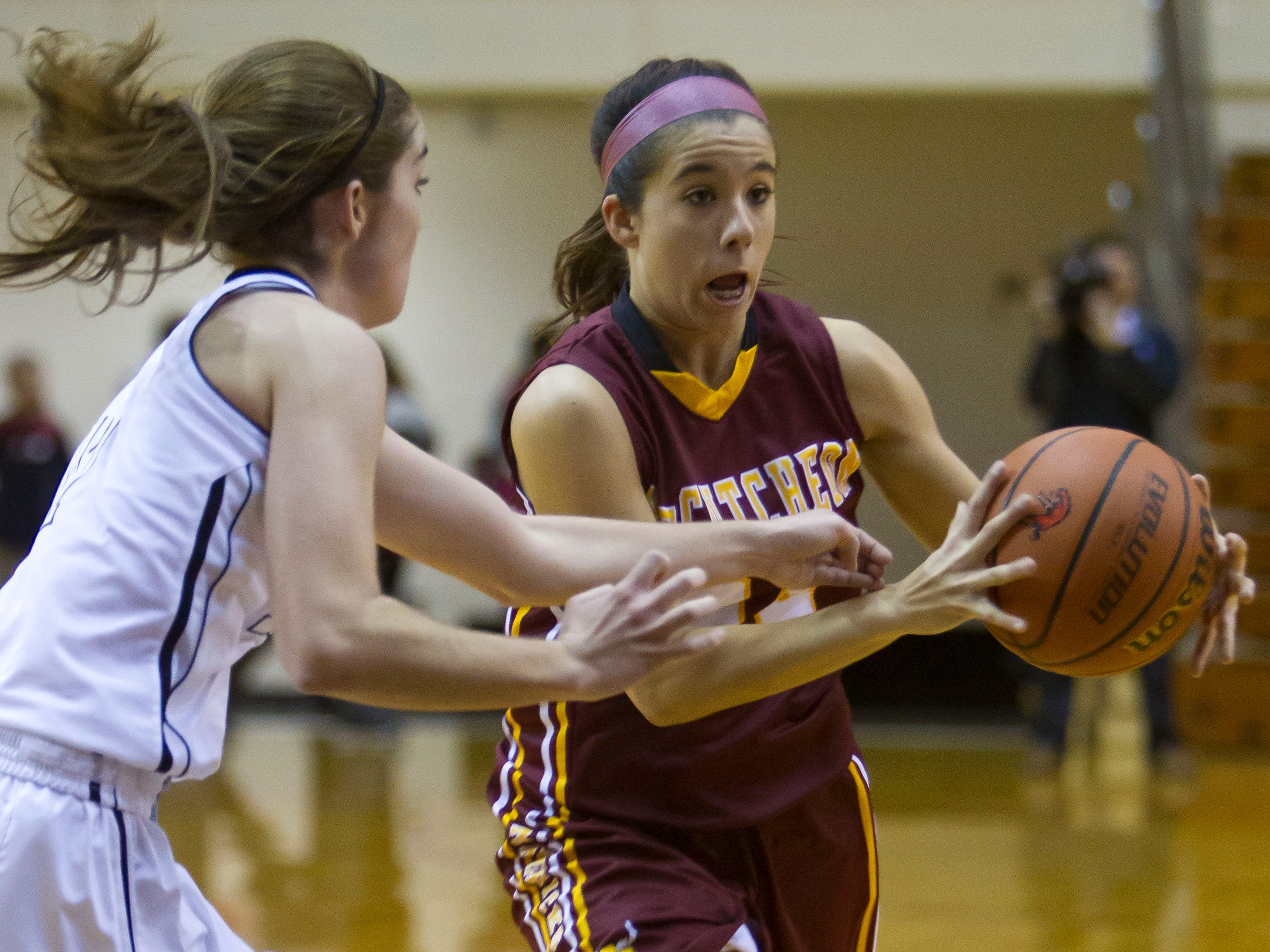 McCutcheon's Kerstyn Lowery, 24, drives to the hoop around Lafayette Jeff's Rylie Pittard, 12, Thursday, January 16, 2014, at Jeff High in Lafayette. McCutcheon won 56-40.