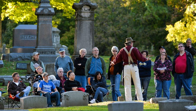 The Prairie Folklore Theatre performs during the Historic Springdale Cemetery Tour in Peoria, Ill. The cemetery's marketing campaign includes a 5K race and actors dressing as people buried there, in an effort to encourage lot sales.