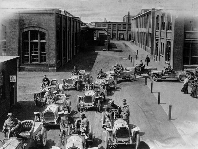 Packard cars go for a road test inside the grounds