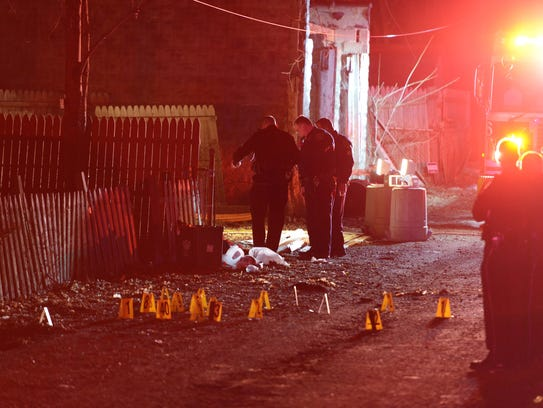 Police investigate the scene after a deadly shooting